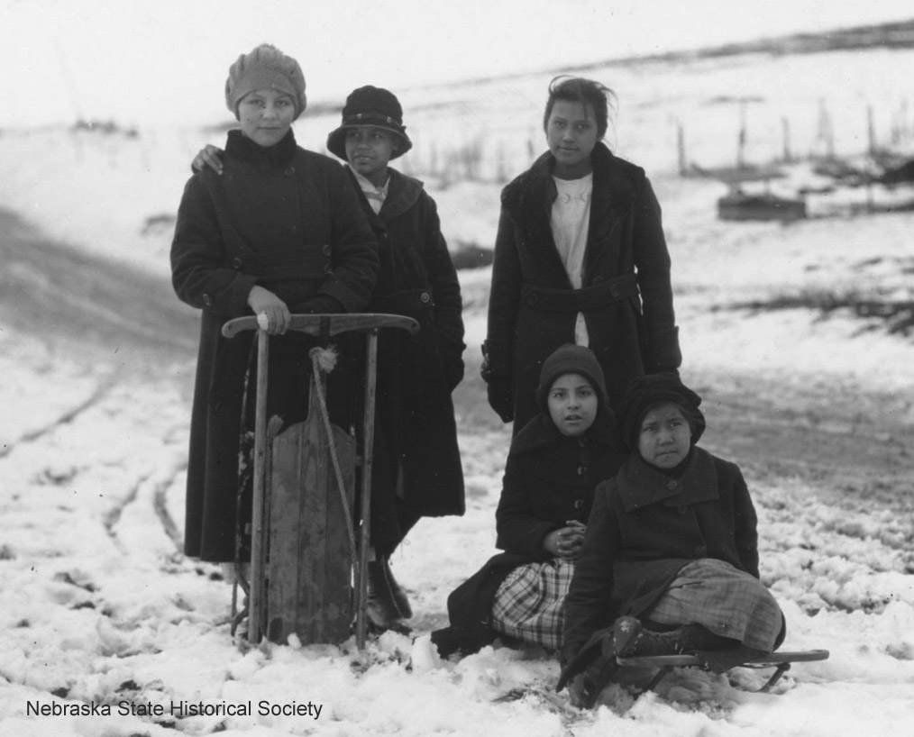 Five Winnebago children with sleds (RG2010.PH0-000025)