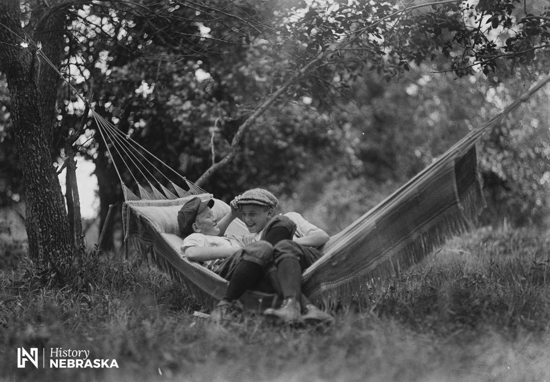 Two boys in a hammock, ca. 1915 (RG2836.PH0-000189)