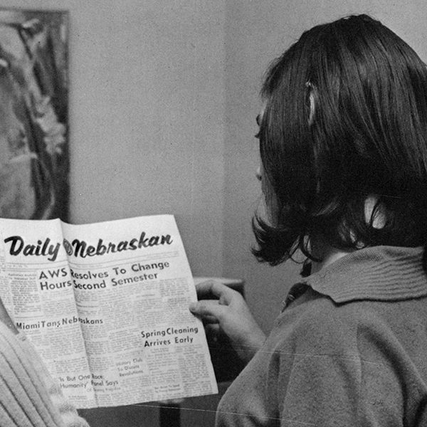 Young woman reading Daily Nebraskan, 1966