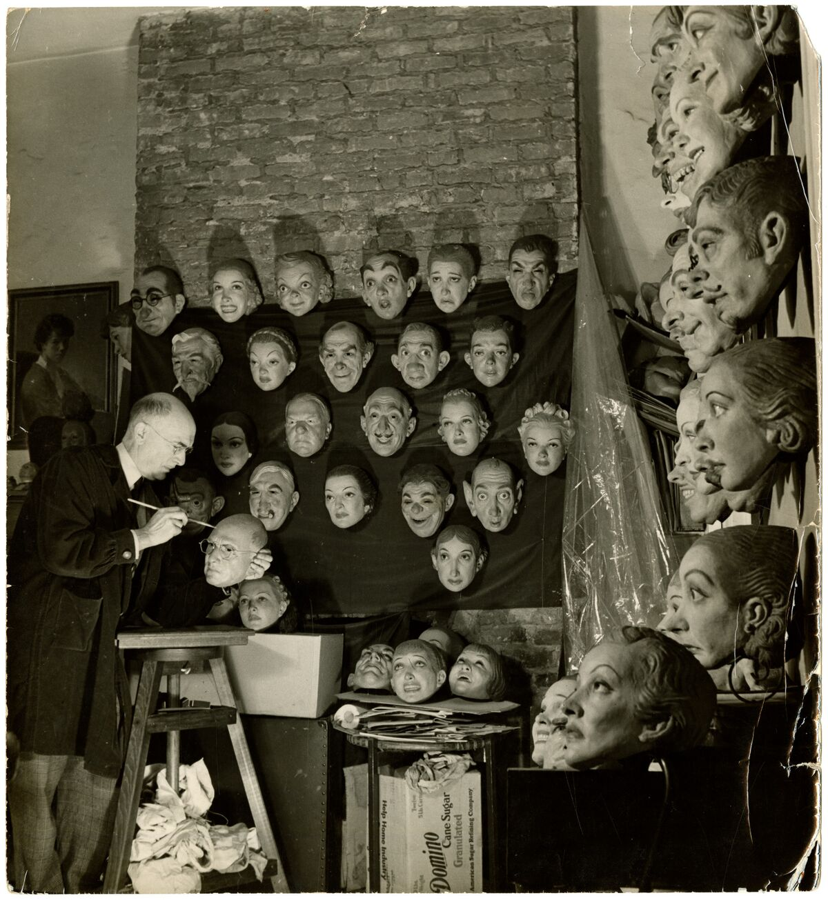 Doane Powell with wall of masks
