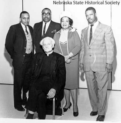 Mildred Brown with the Rev. John Markoe, S.J. (front). The other men in the photo are not identified. NSHS RG5503-8