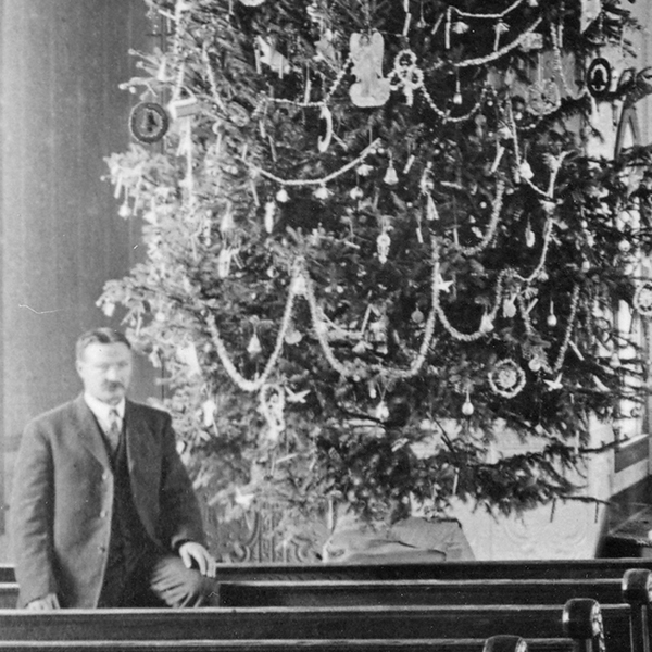 Man beside Christmas tree