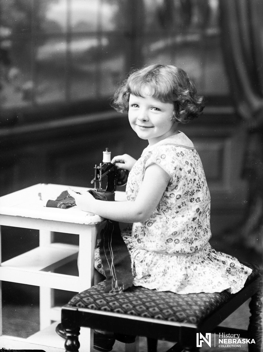 Jo Ann Grimes with toy sewing machine, 1929 (RG5385.PH000029-000065)