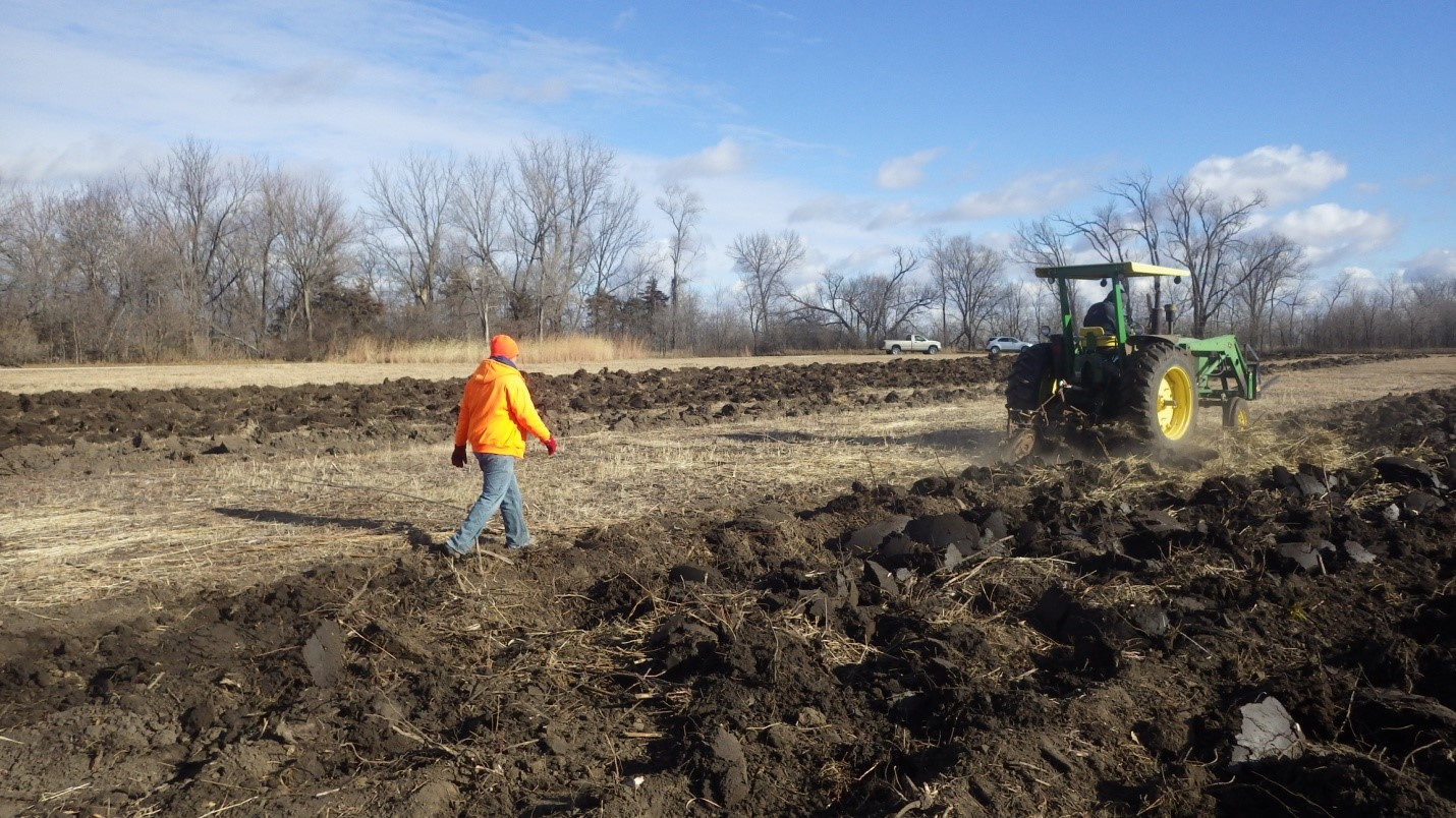 Figure 4: NSHS Archeologist Nolan Johnson following the plow to look for artifacts