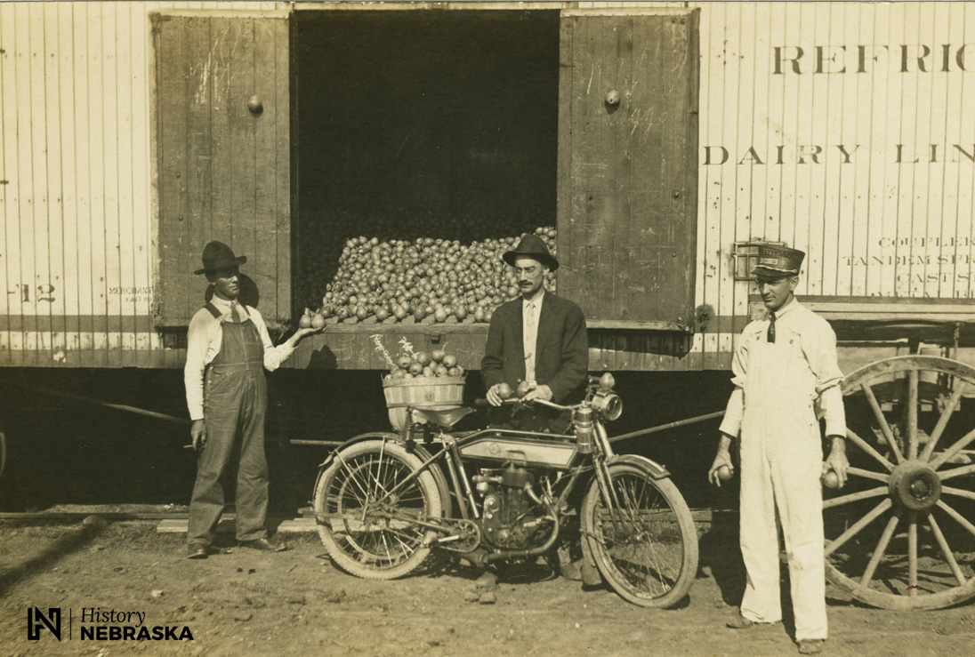 Selling pears from a train car (RG3372.PH000013-000019)