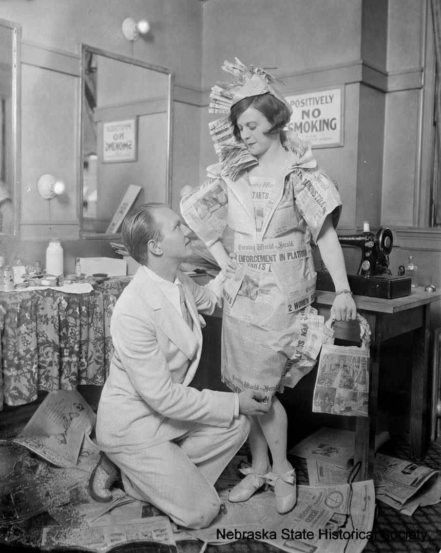 Woman wearing a dress made from Evening World-Herald, an Omaha newspaper, June 1928. [RG3882.PH0045-0126]