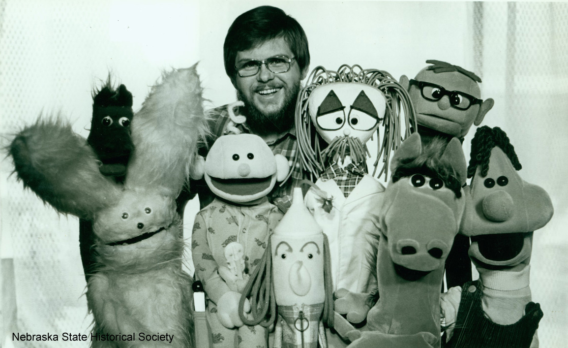 George Churley surrounded by his puppets [RG5865.PH11]