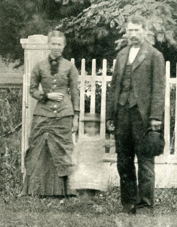 Susie and John Buck in front of their Sutton, Nebraska, home.