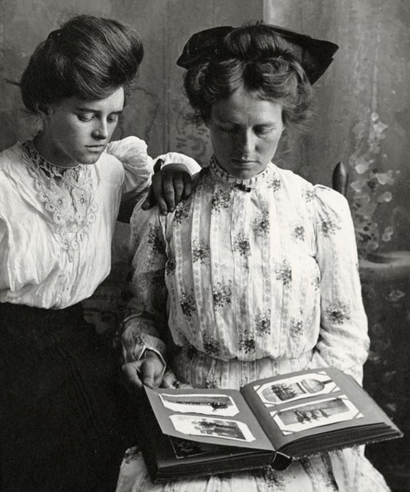 Unidentified women looking at photograph album, about 1907-1917 (RG3542.PH:069-02)