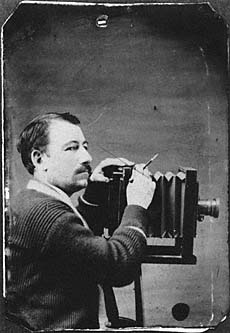Solomon D. Butcher with camera