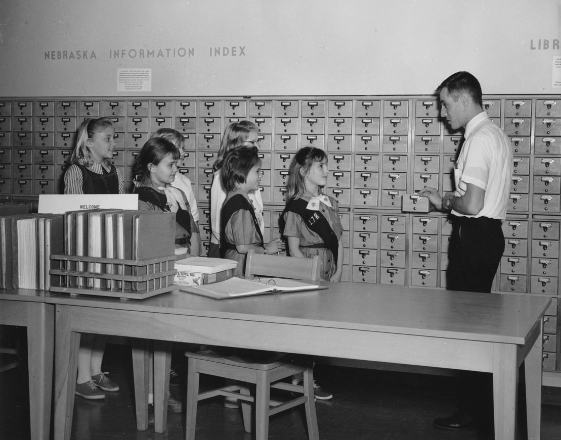William Schmidt and girl scouts at the Nebraska State Historical Society, April 1963. [RG0014.PH000030-000001]