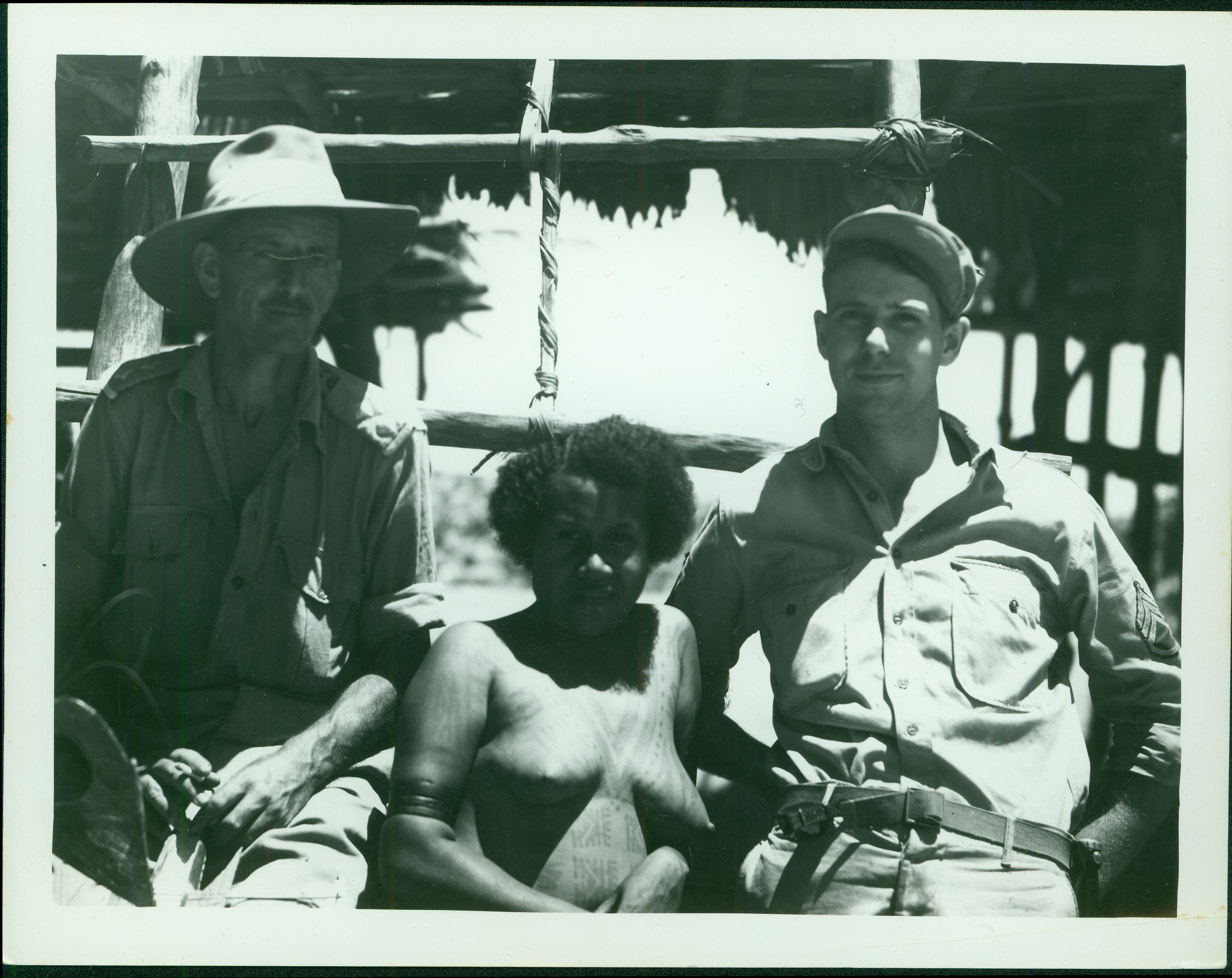 Merchant with Australian Lieutenant pose with native woman [RG5841-1-18]