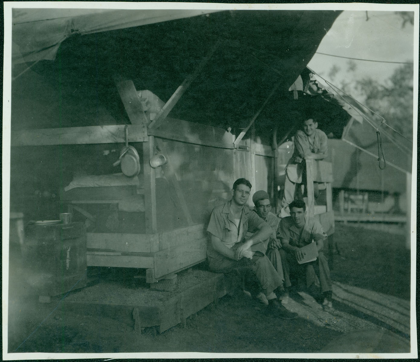 Merchant and friends outside living quarters [RG5841-9-8]