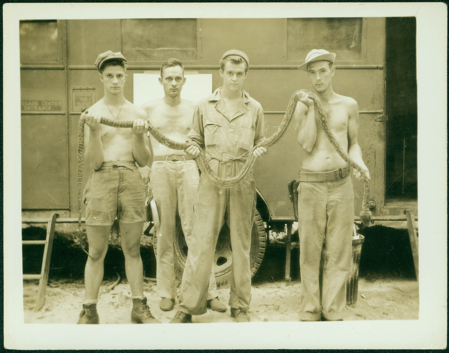 Men pose with snake [RG5841-9-9]