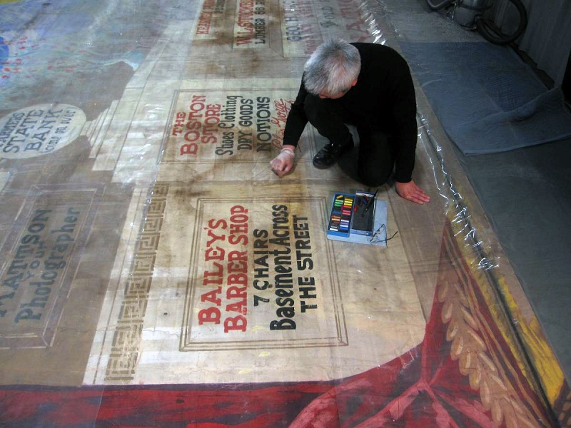 Kenneth Bé working on the Kearney Opera house curtain.