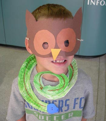 Kid with a paper mask covering his face