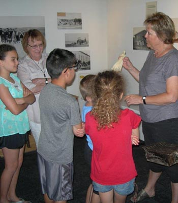 Woman giving a tour to children