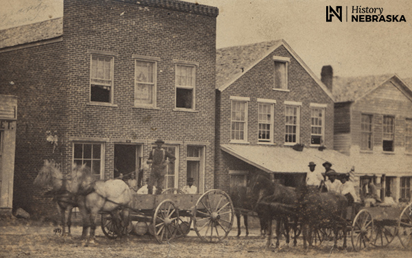 1860s street scene. African Americans driving horse-drawn wagons