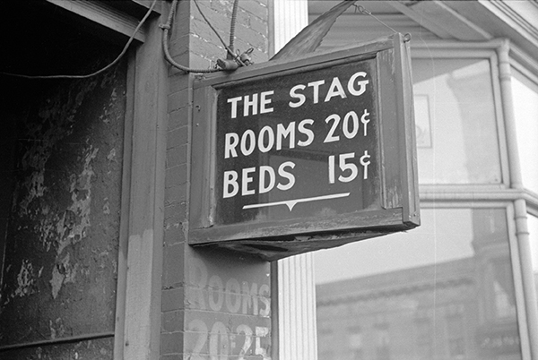 "Hotel sign: ""The Stag / Rooms 20¢ / Beds 15¢"""