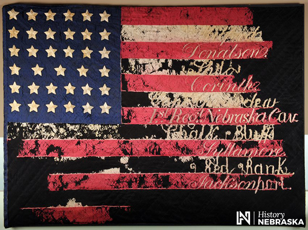 Battle flag of 1st Nebraska cavalry, with names of battles stitched on stripes: