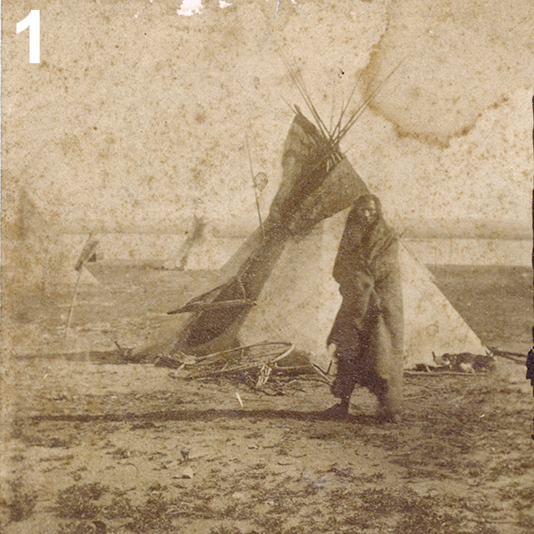 photo of Native American man by tipi