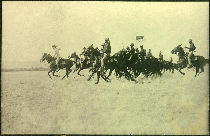 Troop I, Tenth Cavalry at full gallop, Fort Robinson, about 1904.