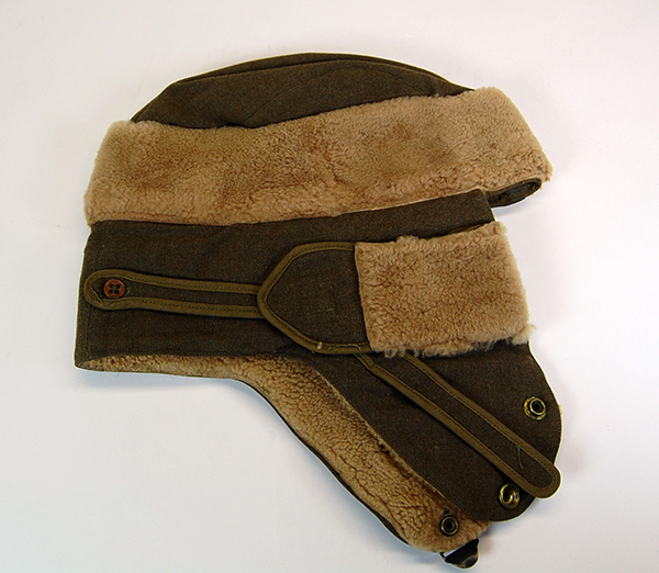 Cold-weather military cap used at Fort Robinson by 1st Lt. Robert H. McCaffree during World War II. The fort housed a prisoner-of-war camp and a war dog training facility. NSHS RG11475-1