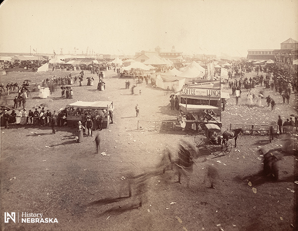 fairgrounds with tents and people