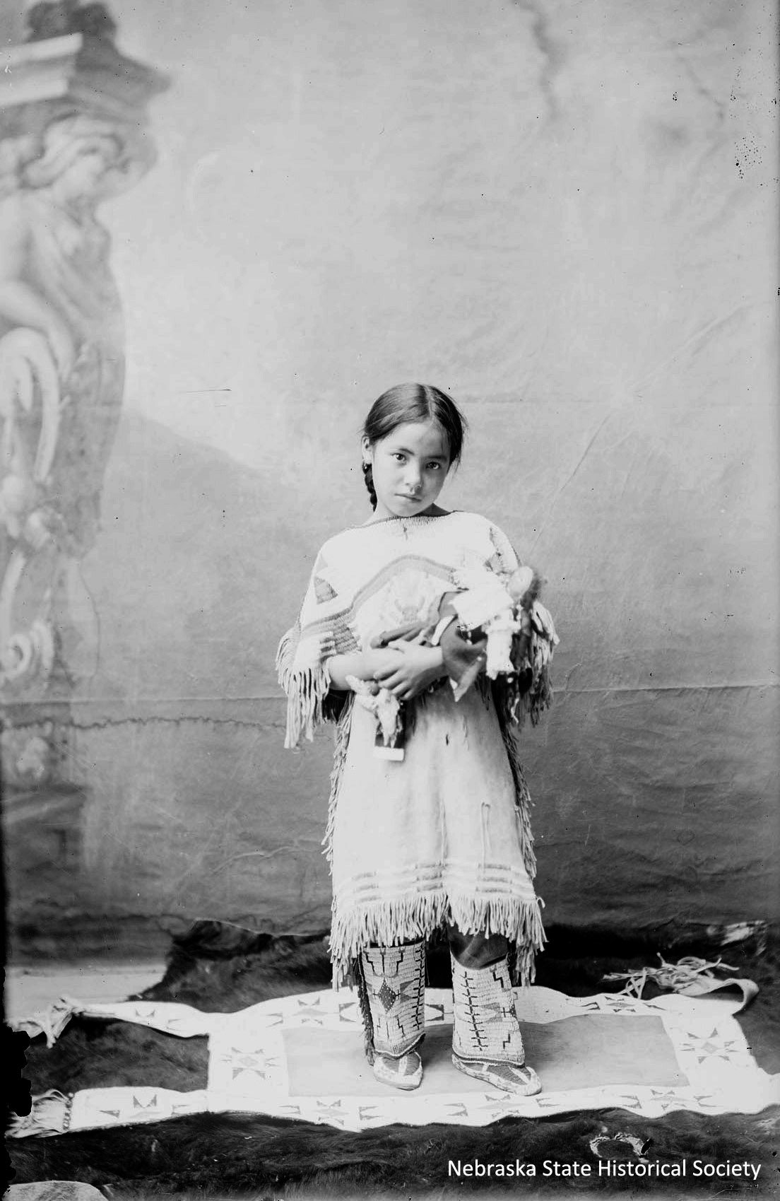 Katie Roubideaux with doll [RG2969-2-165a]