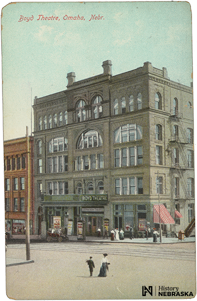 postcard showing five-story brick building