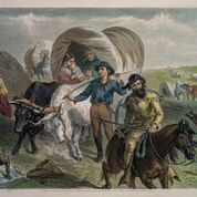 19th century color lithograph showing a covered wagon crossing the prairie