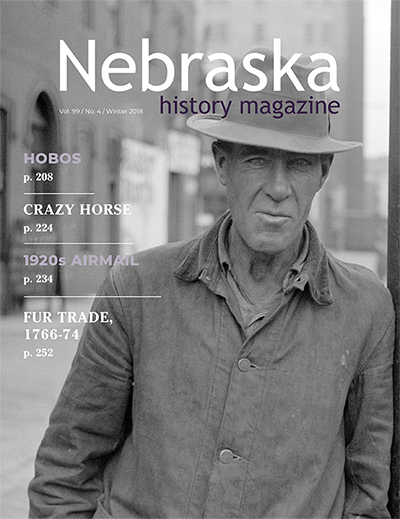 Cover of Nebraska History showing man on Douglas St., Omaha, 1938