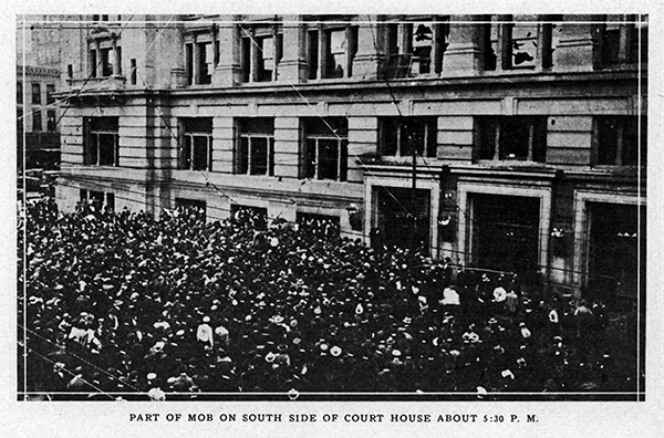 "Original caption: ""Part of mob on south side of court house about 5:30 p.m."""