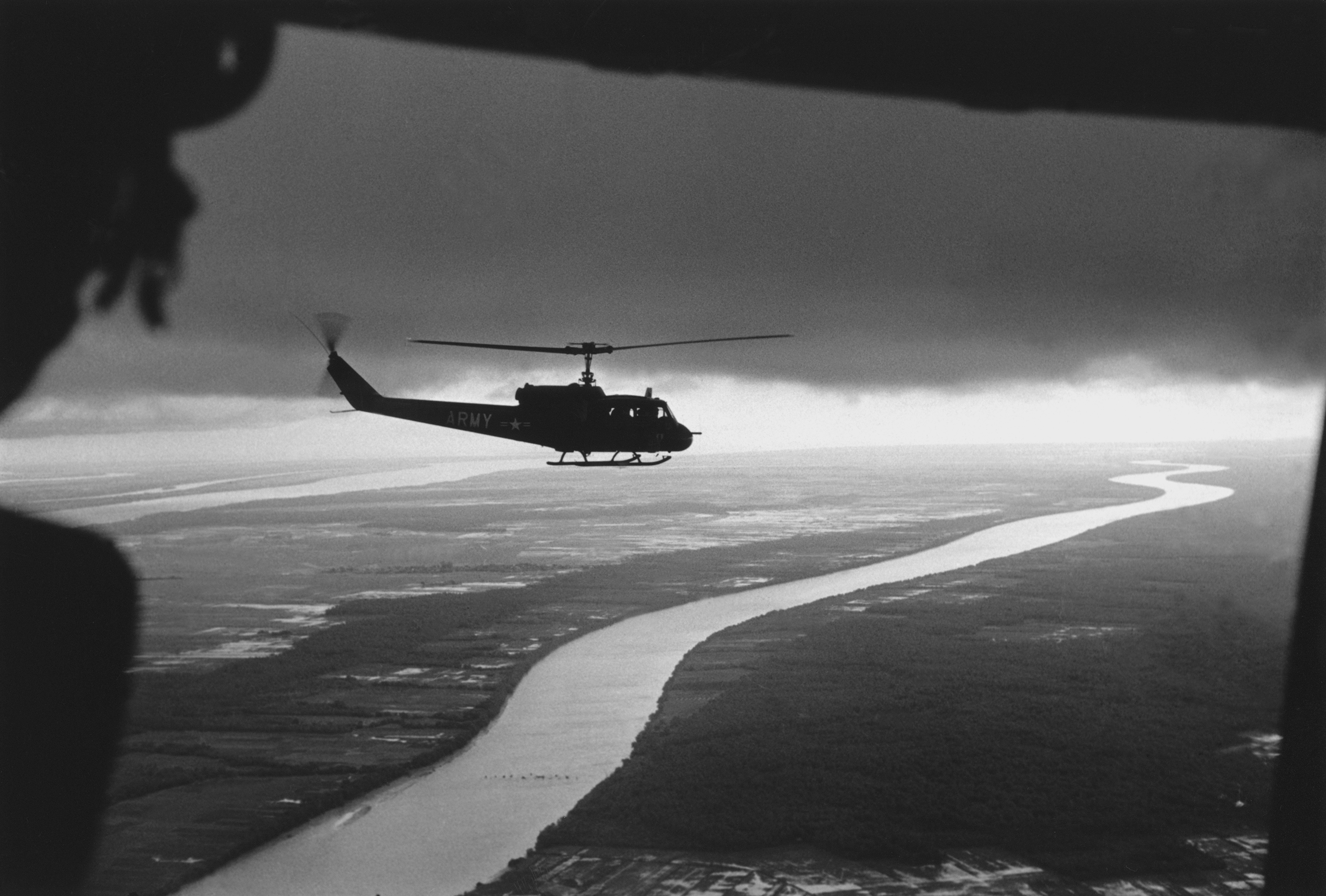 South Vietnamese troops fly over the Mekong Delta-The Vietnam War
