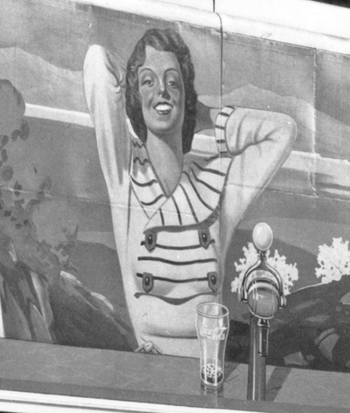 Detail of the corner drug store. Painted image of a woman in an advertisement