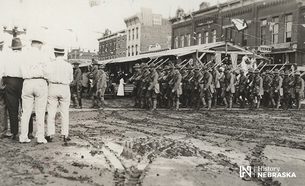 WWI parade, soldiers in muddy street