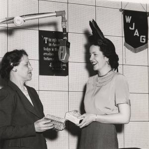 """""""Mary Moore"""" (Maude Werner), left, speaks with Pat McMahon. Courtesy of Roberta Nicholes."""