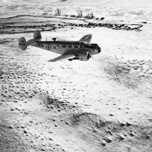 A Nebraska National Guard transport en route to drop hay to stranded cattle during the Blizzard of 1949.