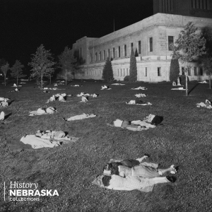 People sleeping on the lawn of the Nebraska State Capitol