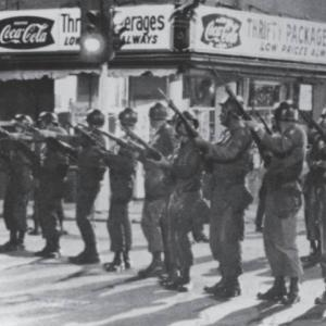 Row of National Guard members in street, 1966