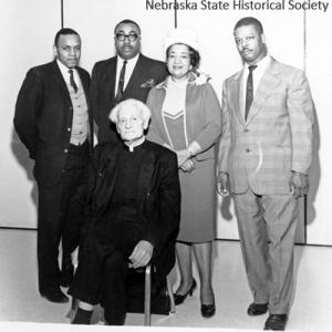 Mildred Brown with the Rev. John Markoe, S.J. (front). The other men in the photo are not identified.