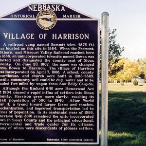 A large metal sign labelled Nebraska Historical Marker that tells the history of the Village of Harrison
