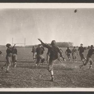 John Nelson's black and white photograph on a postcard of football players.  NSHS RG3542.PH:097-04