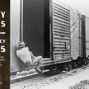 magazine spread with photo of man swinging himself up into a boxcar
