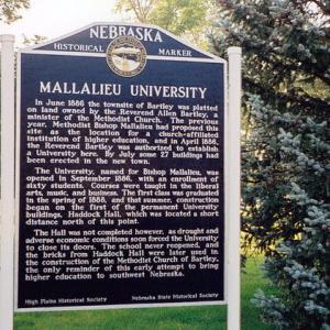 A blue and white metal sign titled Mallalieu University