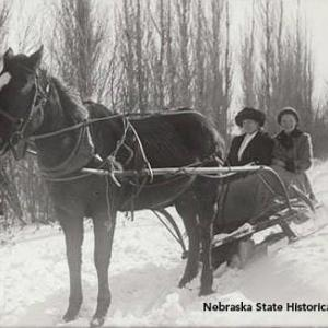 John Nelson's photograph of his sister, Hannah Nelson, and his niece, Alice Nelson Dahlesten, in a horse-drawn sleigh, about 1916-18