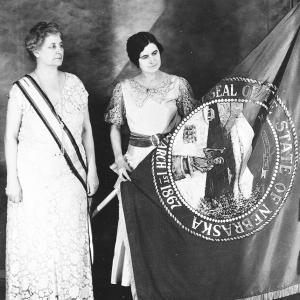 two women with the Nebraska state flag