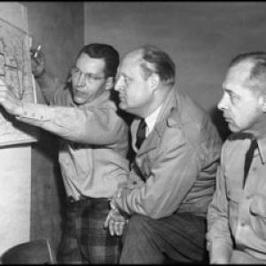 Governor Val Peterson, center, reviewing relief plans during the blizzard of 1949.