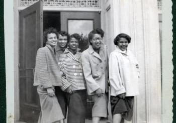 Joyce Williams poses with friends, 1953