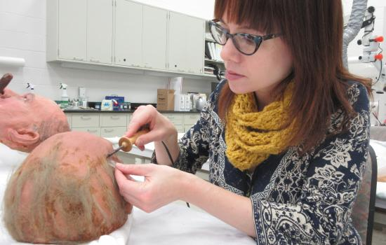 Rebecca Cashman working on Doane Powell Mask Collection
